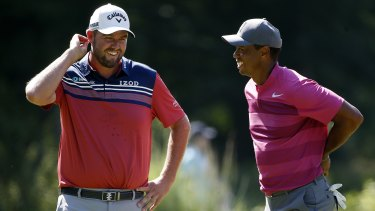 Contending: Tiger Woods (right) and Australia's Marc Leishman are both in the mix.