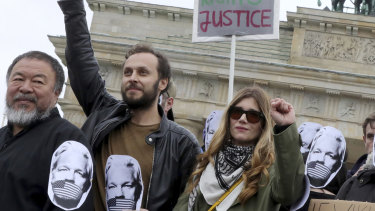 Chinese artist Ai Weiwei, left, at a demonstration in Berlin last month against extradition of Julian Assange to the US.