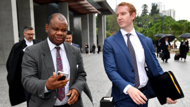 Dr Tony Mufutau Oluwatoyin Bakare (left) outside Brisbane District Court this week.