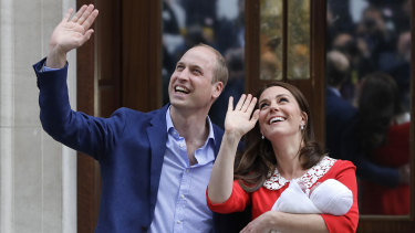Prince William and Kate, Duchess of Cambridge, hold their newborn son outside St Mary's Hospital.