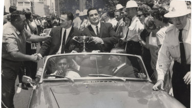 Summons and Ian Walsh parade the Ashes Cup through the streets of Sydney on their triumphant return to Australia in 1964.