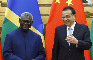Solomon Islands Prime Minister Manasseh Sogavare with Chinese Premier Li Keqiang at a ceremony at the Great Hall of the People in Beijing in October.