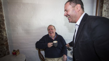 Newly-appointed deputy Liberal leader and federal Treasurer Josh Frydenberg, right, shares a coffee and a laugh on Saturday morning with former treasurer Peter Costello.