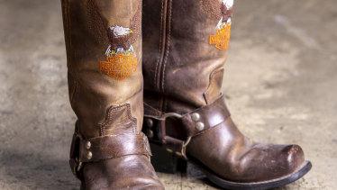 Harley Davidson cowboy boots, $150.