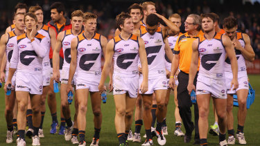 Kevin Sheedy and his GWS side walk off the ground after a loss to Carlton in 2013.