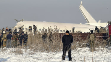 Rescuers attend the scene of the plane crash near Almaty International Airport, Kazakhstan.