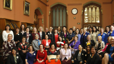 The lawmakers were re-enacting a 1905 photograph, which featured only male lawmakers, as part of the 125th anniversary celebrations of New Zealand becoming the first country to give women the right to vote.