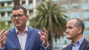 Premier Daniel Andrews and deputy James Merlino the day after being re-elected.