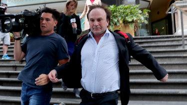 Reinier Jessurun runs from court on Thursday.