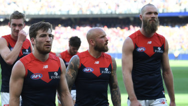 Jack Viney, Nathan Jones and Max Gawn lead the Demons off the field after their preliminary final loss to West Coast