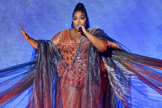 Lizzo performs during the Brit Awards.