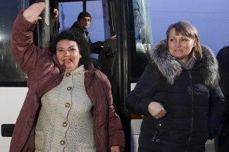 A Ukrainian war prisoner leaves a bus after being released near Odradivka, eastern Ukraine.