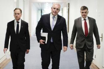 Health Minister Greg Hunt (left), Prime Minister Scott Morrison and then Chief Medical Officer Professor Brendan Murphy in March 2020.