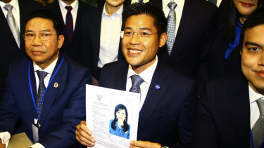 Thai Raksa Chart party leader Preecha Pholphongpanich holds a picture of Princess Ubolratana, announcing she will be their prime ministerial candidate.