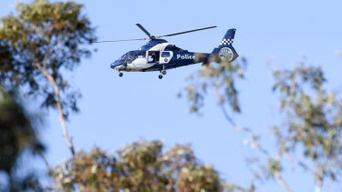 A police helicopter hovering over the scene on Saturday afternoon.