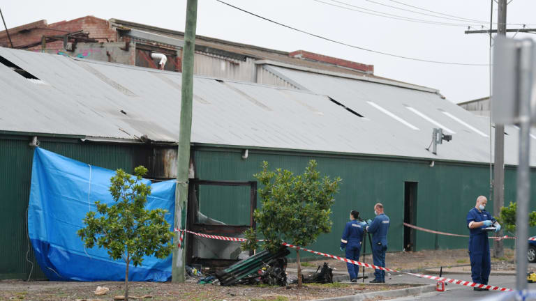 Police and forensic officers at the scene of the abandoned factory the day after the fire in March 2017.