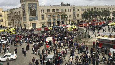 People gathering outside Ramsis train station in Cairo after the accident.