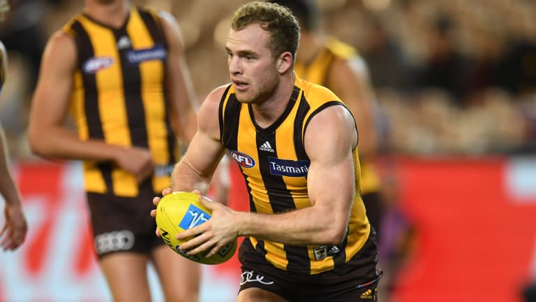 On the ball: Tom Mitchell in action against Adelaide.
