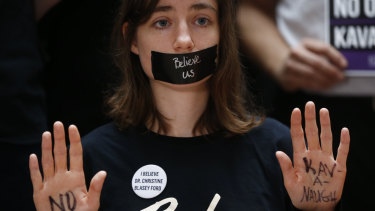 """A protester displays a note on her hands that reads """"No Kavanaugh"""" while demonstrating ahead of a Senate Judiciary Committee hearing in Washington DC this week."""
