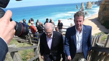 Prime Minister Scott Morrison and  Education Minister Dan Tehan at the Twelve Apostles on Monday.