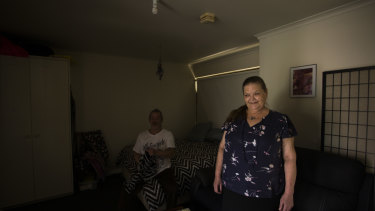 """Kathy Watts and her partner Tom inside her new Coburg home, which she describes as her """"mini palace""""."""