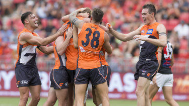 Giants celebrate a Lachlan Keeffe goal on Sunday against Essendon.