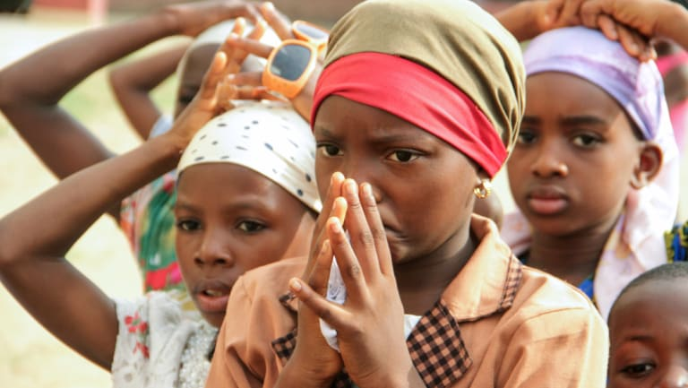 Children pray as Christian community members take part in a protest against the killing of people by suspected herdsmen in Makurdi, north-central Nigeria in April.