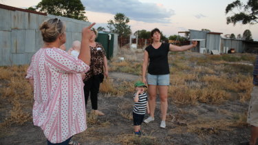 Lara English (left) and Lauren Mathers look at the proposed site for the micro-abattoir.