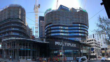 Multiplex has 'topped out' LK Property Group's 10-level Capitol Grand tower.