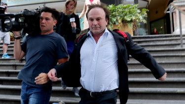Reinier Jessurun runs from court on Thursday.