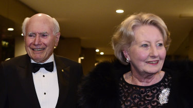 John and Janette Howard arrive at the club for his 80th birthday party on July 26.