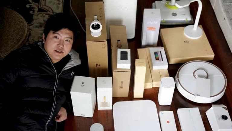 Superfan Pan Weida, 31, shows off some of his Xiaomi gear.