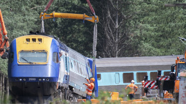 A sling on a crane is used to move part of the XPT train in Wallan on Sunday.