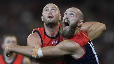 Tap and go: Essendon's Tom Bellchambers goes up in a ruck contest against Melbourne big man Max Gawn.