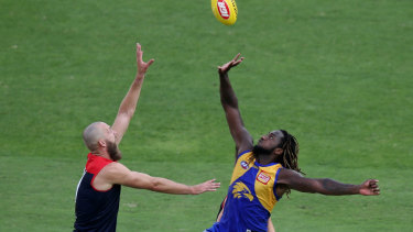 Up 'n' at 'em: West Coast's Nic Naitanui in a ruck battle with Max Gawn.