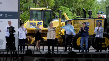Indigenous people of Mexico's Yucatan peninsula are worried the train line will destroy their way of life. Above, the President launches the project.