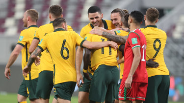 Plenty to smile about ... Socceroos players celebrate Awer Mabil's (11) goal against Oman.