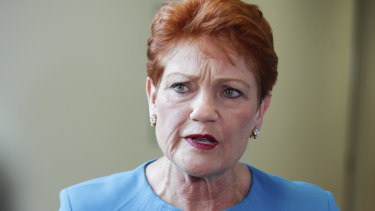 One Nation Senator Pauline Hanson applauded as the result of the vote was announced in the Senate.