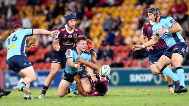 Waratahs five-eighth Will Harrison in action against the Reds in round one last year.