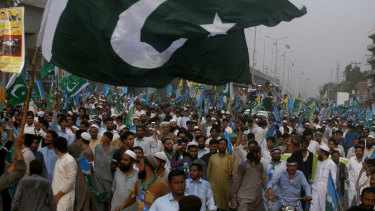 Supporters of the religious group Jamaat-e-Islami participate in a rally to express solidarity with Indian Kashmiris in Peshawar, Pakistan, on Sunday.