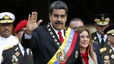 Venezuelan President Nicolas Maduro greets the media after his re-election.