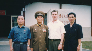 Criminal solicitor Jack Dalziel (second right) with Jon Hak-bom (far right) and Kim Chu-nam (far left)