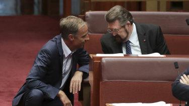 Greens senator Nick McKim discusses the bill with Derryn Hinch on Wednesday.