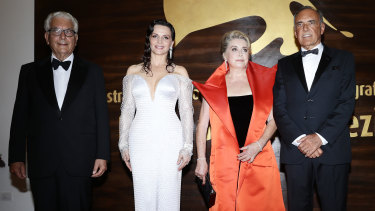 President of Venice Film Festival Paolo Baratta, Juliette Binoche, Catherine Deneuve and festival director Alberto Barbera at the opening ceremony of the 76th Venice Film Festival at Sala Casino in Venice, Italy, on Wednesday.