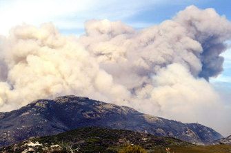 Smoke rising from the Wilsons Promontory fire that ran out of control and forced the evacuation of hundreds of trapped visitors in 2005.