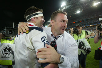 Ricky Stuart and Brad Fittler celebrate premiership success in 2002.