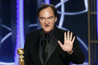 Quentin Tarantino accepts the award for best screenplay for Once Upon a Time...in Hollywood.