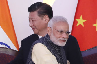 Indian Prime Minister Narendra Modi, front and Chinese President Xi Jinping at the BRICS summit in Goa, India, in 2016.