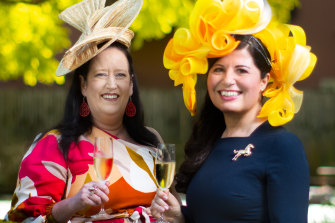 All frocked up ... Jo Eltringham (left) and Doris Jovic warm up for their Melbourne Cup party.