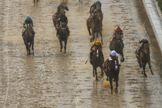 Justify claims victory in muddy conditions in the 2018 Kentucky Derby.